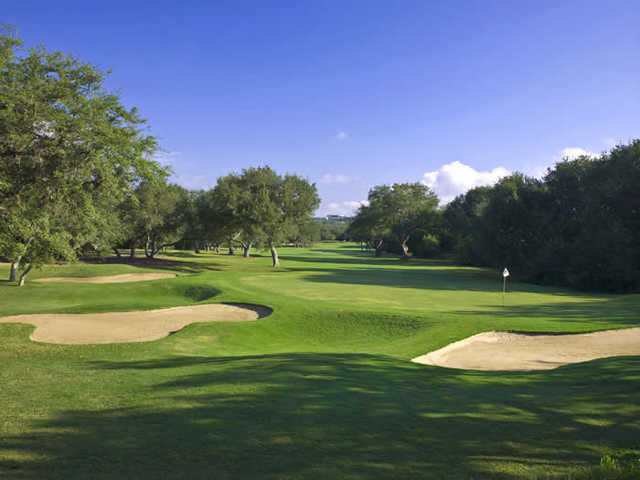 A view of a green protected by bunkers at Hill Country Golf Club