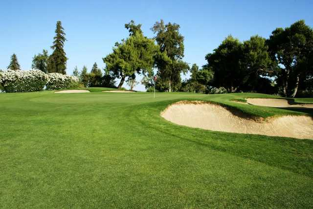 A view of a green protected by tricky bunkers at Turlock Golf & Country Club.