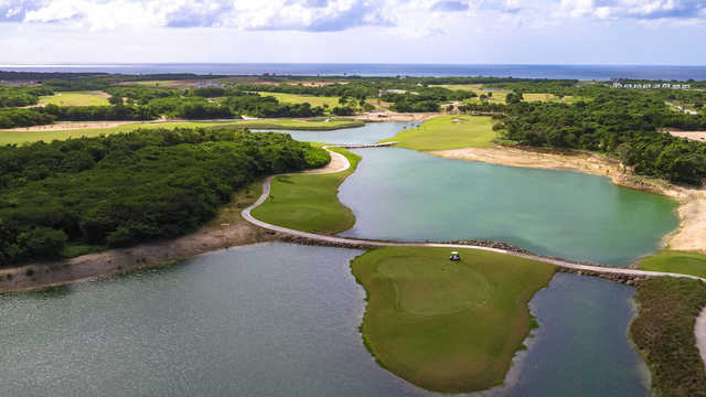 A view of a green surrounded by water at Ocean's 4 Golf