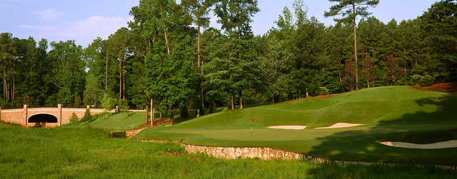 A view of a green with bunkers on the right at Cobblestone Park Golf Club