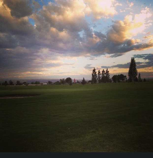 An evening view of a green at Pleasant Valley Golf Course.