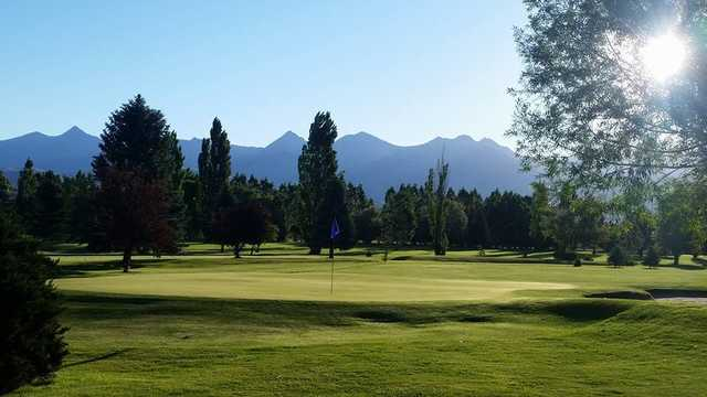 A sunny day view of a hole at Salmon Valley Golf Course.