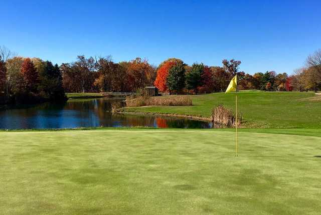 A fall day view of a hole with water in background at Eastwood Golf Course.