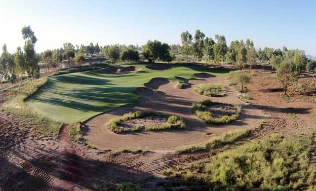 View of a green with bunkers at Ak-Chin Southern Dunes Golf Club