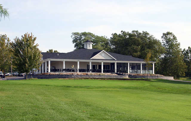 A view of a  green and the clubhouse at Heritage Hills Golf Course.