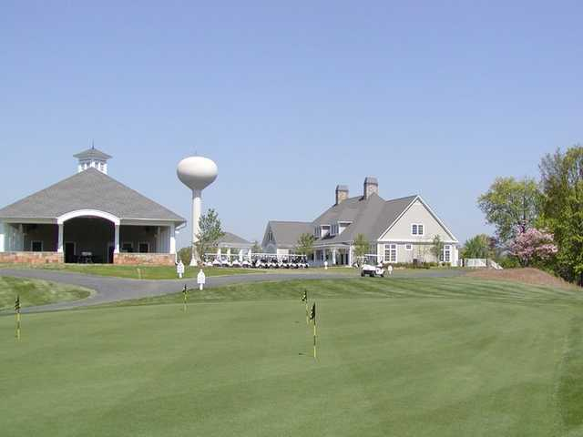 A view of the putting green with clubhouse in background at Tega Cay Golf Club