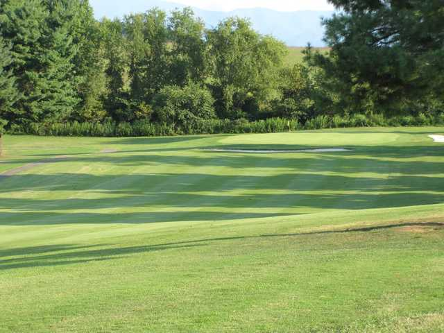 A sunny day view of a hole at Twin Creeks Golf Course.