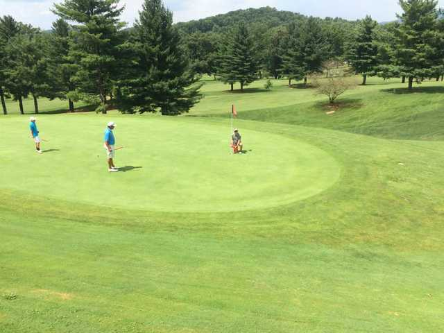 A sunny day view of a hole at Elizabethton Golf Course.