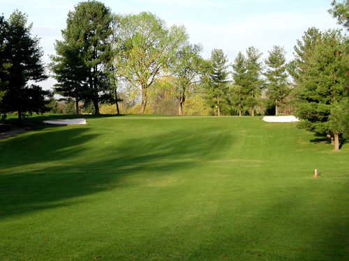 A view of hole #4 flanked by bunkers at Pine Oaks Golf Club.