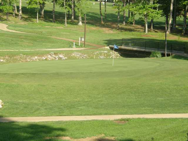 A view of a green with a bridge in background at Lawrenceburg Golf & Country Club.