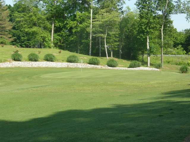 A sunny day view of a hole at Lawrenceburg Golf & Country Club.