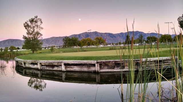 A view of a green surrounded by water at Skyway Golf Course.