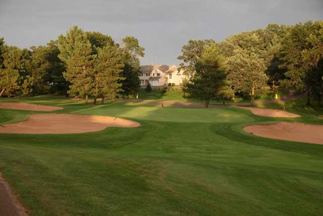 A view of a green surrounded by tricky bunkers from Voyager at Voyager Village Country Club.