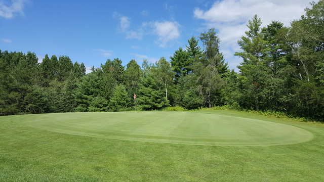 A view of a green at Spider Lake Golf Resort.