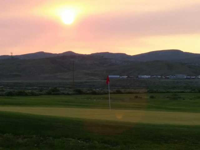 A sunset view of a green at White Mountain Golf Course.
