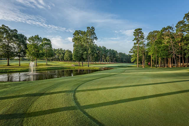 A view of a green with water coming into play at Calvert Crossing Golf Club.