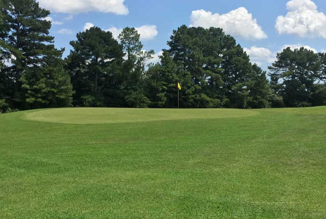 A view of a green at Whispering Pines Golf Club.