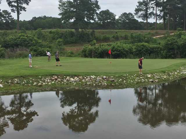 A view of a green with water coming into play from Cedar Creek Golf Course at Quitman Country Club.
