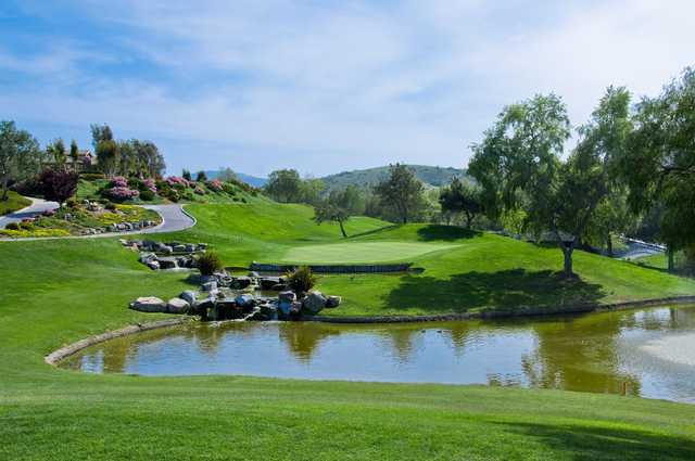 A view over the water of hole #9 at Twin Oaks Golf Course.
