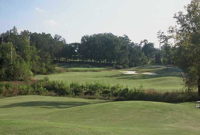 A view of green #18 from faiway at The Challenge Golf Club