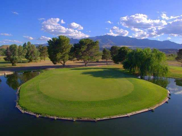 A view of green #14 surrounded by water at Mt. Graham Golf Course.