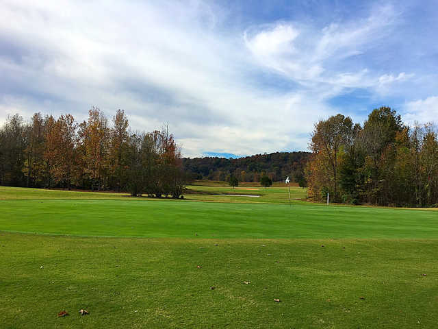 A fall day view of a green at Tennessee River Golf Club.