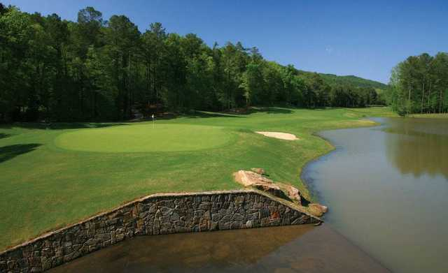 A view of the 9th hole surrounded by water at Limestone Springs Golf Club.