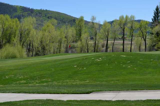 A spring day view of a green at Catamount Ranch and Club.