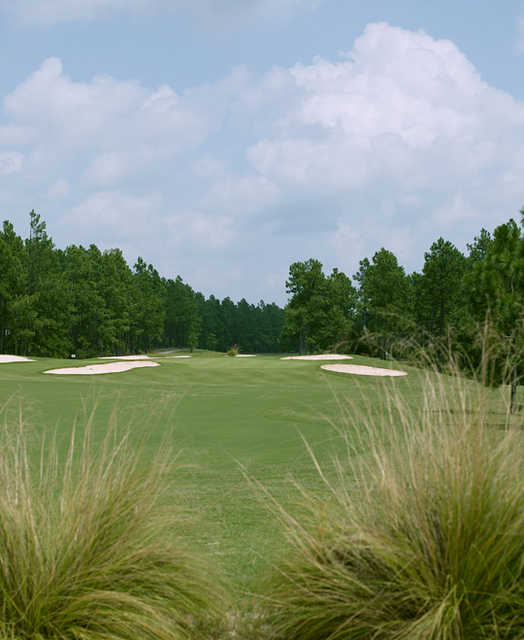 A view of a green protected by bunkers at Foxfire Resort & Golf Club