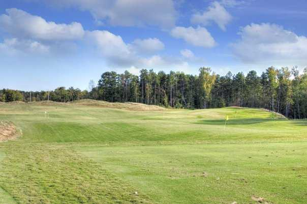 A view of the driving range at Red Bridge Golf & Country Club