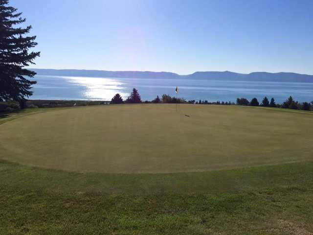 A sunny day view of a hole at Bear Lake West Golf & Country Club.