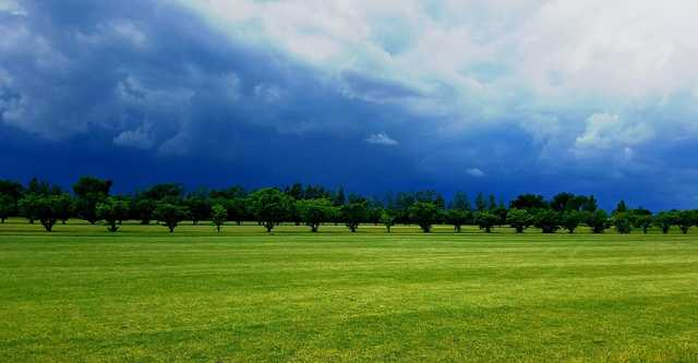 A view of storm clouds over a fairway at Star City Golf Course.