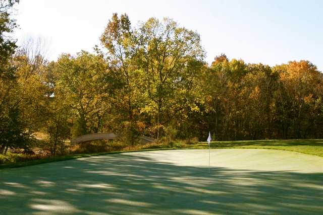 A fall day view of green #7 from The Club At Old Hawthorne.
