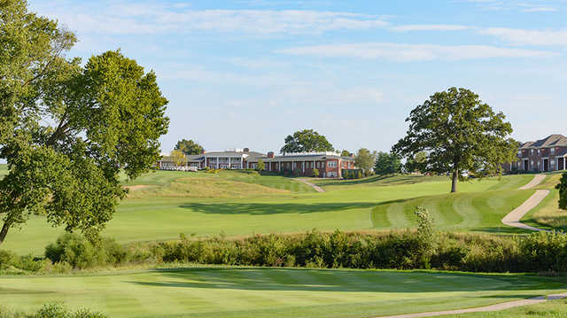A view of a fairway and the clubhouse from The Club At Old Hawthorne.