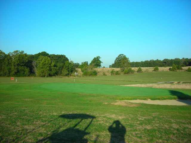 A view of a green at Oakwood Golf Club.
