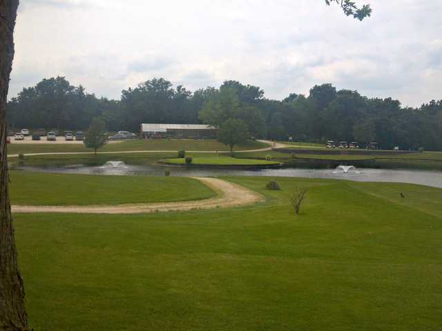 A view of green #9 surrounded by water at Three Pines Golf Course.