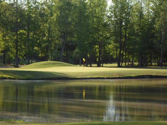 A view over the water of a hole from The Ridges at Village Creek.