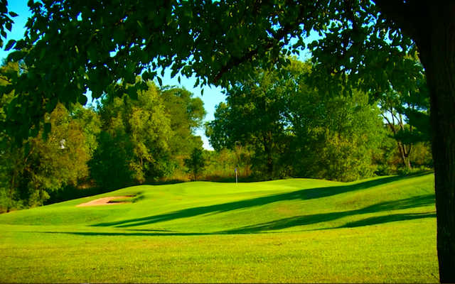 A sunny day view of a hole at Hidden Creek Golf Club.
