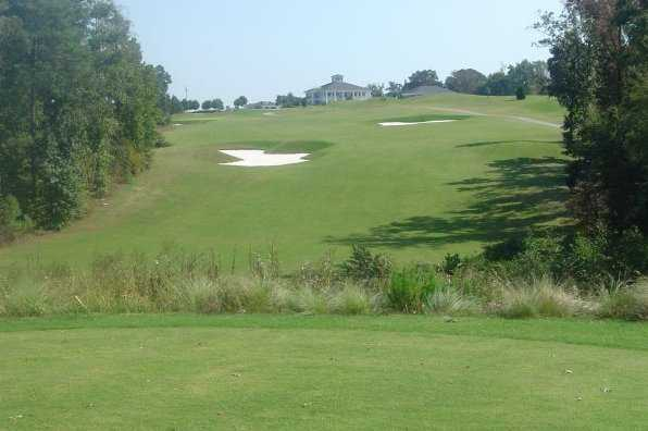 A view of the 18th hole with clubhouse in background at River Ridge Golf Club