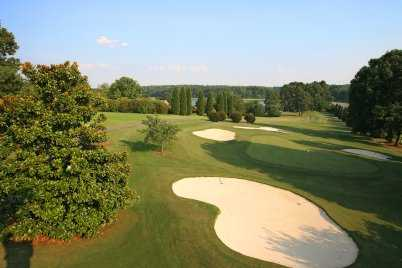 A view of hole #15 protected by bunkers at Carolina Trace Country Club - Lake Course