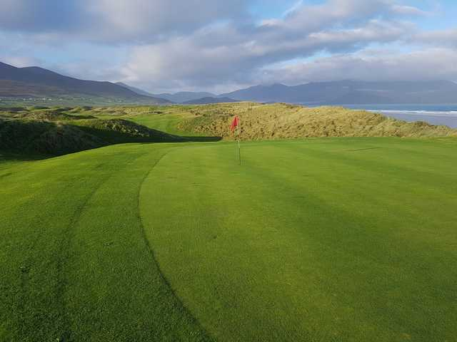 A sunny day view of a green at Castlegregory Golf Club.