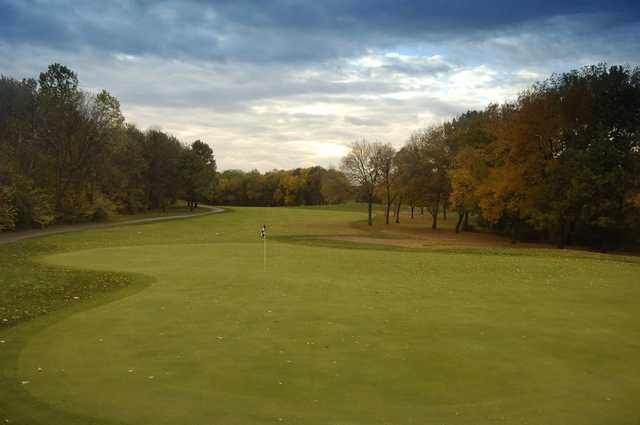 A fall day view of a hole at George W Dunne National Golf Course.