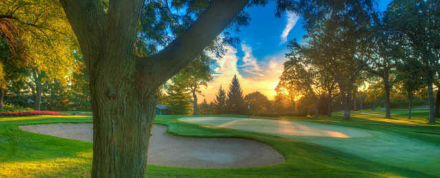 A sunny day view of a hole at Elgin Country Club.
