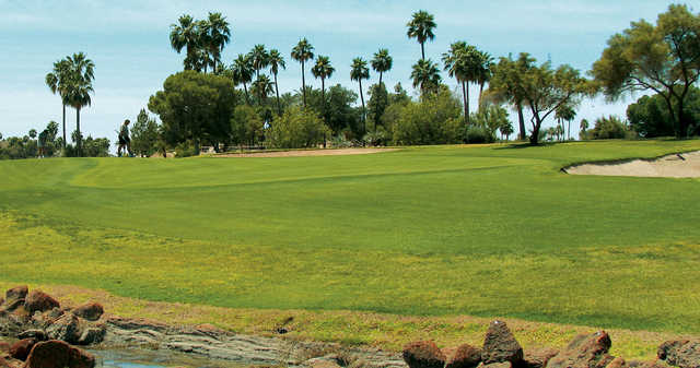 A view of a green protected by bunkers at Hillcrest Golf Club from Sun City West.