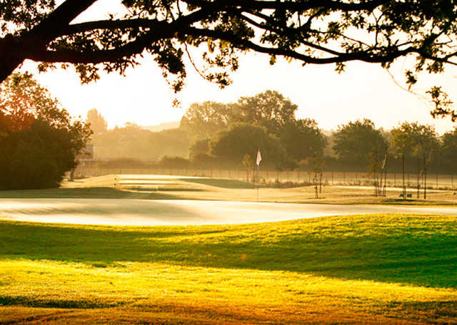 A sunny day view of a green at Playgolf Colchester.