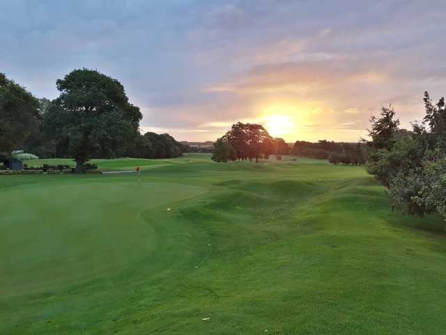 A sunset view of a green at Kenwick Park Golf Club.