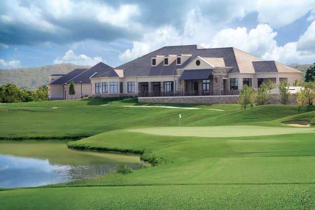 A view of a green and the clubhouse at WinStar Golf Course.