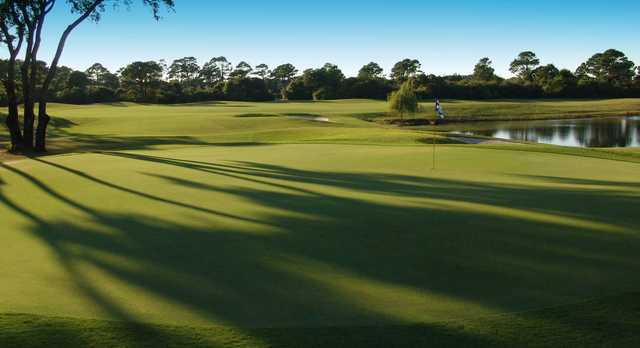 A sunny day view of a hole with water coming into play at Amelia River Golf Club.