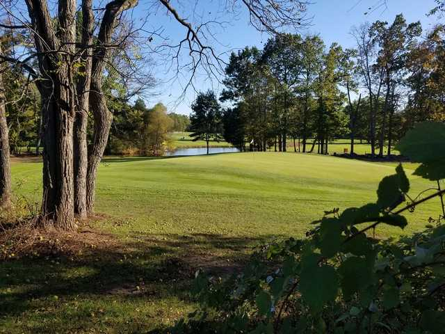 A sunny day view of a hole at Fox Hollow Golf Club.
