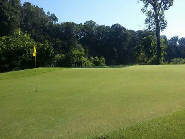A sunny day view of a hole at River Islands Golf Club.